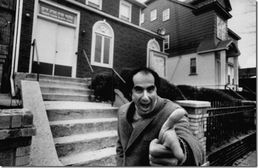 Comic face made by author, Philip Roth, while standing near Jewish center and Hebrew school he probably attended as a boy.  (Photo by Bob Peterson//Time Life Pictures/Getty Images)